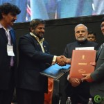 Shri Narendra Modi Congratulating Delegates for Signed MoU at Convention by Vivekananda Yuva Parishad- Vibrant Gujarat Summit 2013-Gandhinagar Gandhinagar, Gujarat, India.