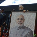 wShri Narendra Modi with Gifted Collage Photograph by at Convention by Vivekananda Yuva Parishad- Vibrant Gujarat Summit 2013-Gandhinagar Gandhinagar, Gujarat, India.