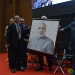 Shri Narendra Modi Was Gifted Collage Photograph by Shri Bhagyesh Jha at Convention by Vivekananda Yuva Parishad- Vibrant Gujarat Summit 2013-Gandhinagar Gandhinagar, Gujarat, India.